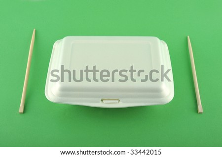 White lunch box in green background - stock photo