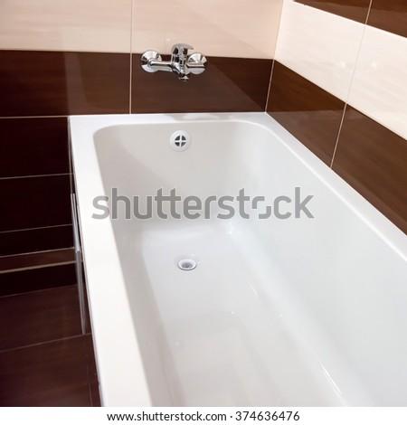 White luxury bathtub in bathroom with ceramic interior - stock photo