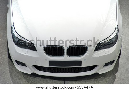 White luxury car - front/top view - stock photo