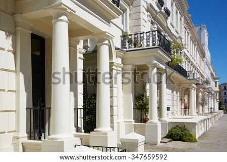 White luxury houses facades in London, borough of Kensington and Chelsea in a sunny day - stock photo