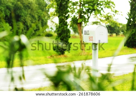 white mail box with green grass - stock photo