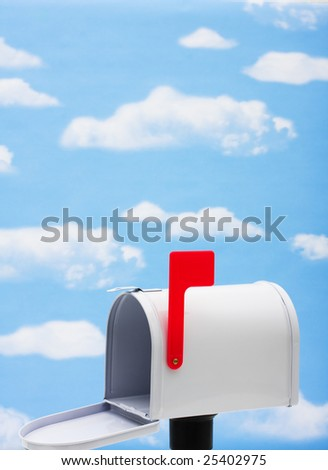 White mailbox with blue sky and cloud background, mailbox - stock photo