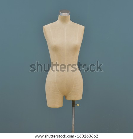 white mannequin-blue background - stock photo