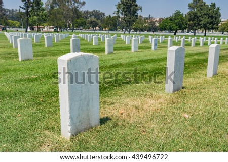 White marble headstones mark final resting place of American soldiers. - stock photo