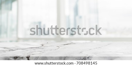 White Marble Stone Table Top And Blur Glass Window Wall Building With City  View Background