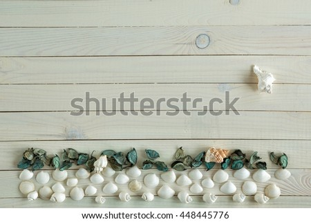 White marine items on wooden vintage background. Sea objects on rustic wooden table. Beach and vacation concept. Seascape made of sea shells. Flat lay, overhead top view - stock photo
