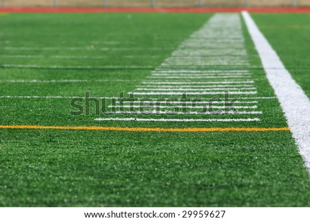 White marking lines on the side of a stadium field.