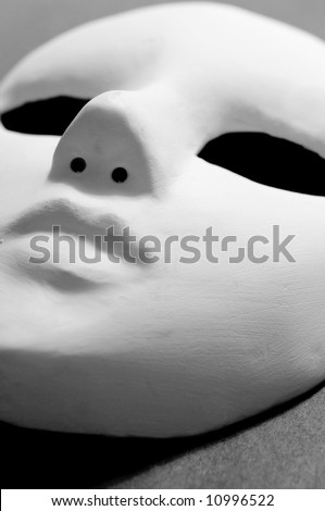 white mask for stage performance on black - stock photo