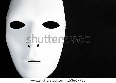 white mask in black isolated - stock photo