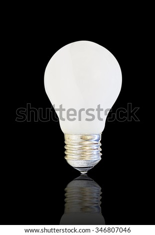 white matte light bulb, isolated on black background with reflection