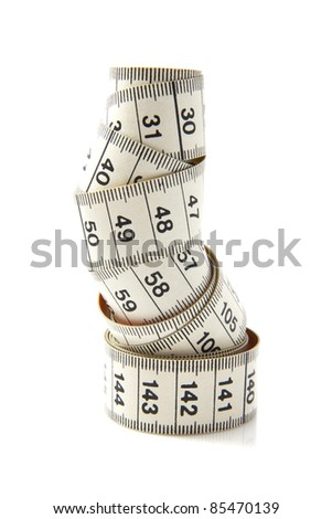 White measure tape rolled up over white - stock photo