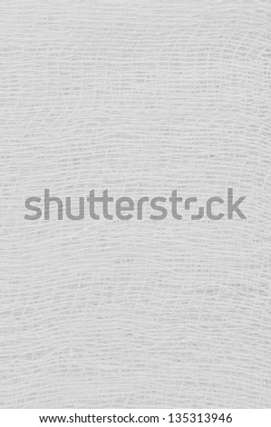 White medical bandage gauze texture, abstract textured background macro closeup, natural cotton linen fabric, vertical copy space pattern - stock photo