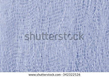 White medical bandage gauze texture, abstract textured background macro closeup, natural cotton linen fabric pattern, horizontal copy space in blue