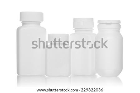 White medical bottles, isolated on white background  - stock photo