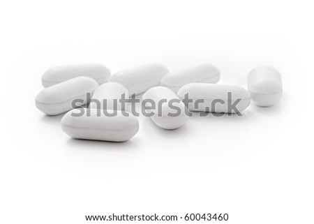 white medical tablets over white