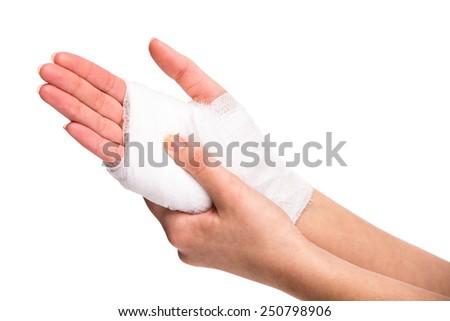 White medicine bandage on injured hand on white background. - stock photo