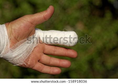 white medicine bandage on injury finger - stock photo