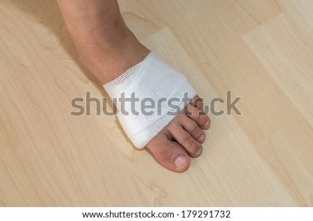 White medicine bandage on injury foot - stock photo