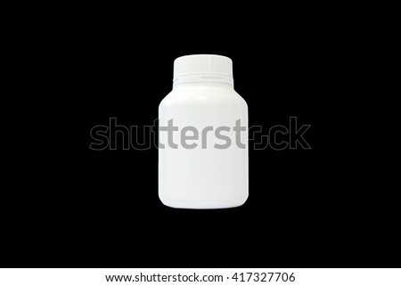 White medicine bottle isolated on black background closeup