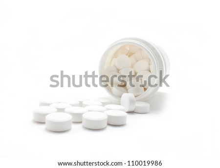 White medicines flow from container. - stock photo