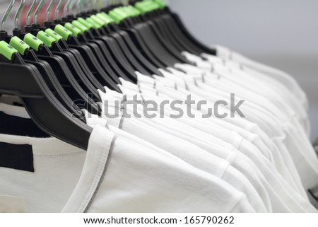 white men T-shirts on hanger - stock photo