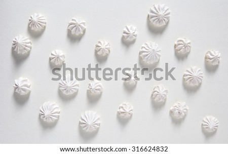 white meringues of different patterns and sizes