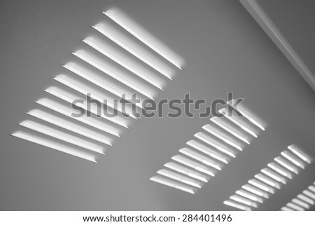 White metal industrial wall with ventilation grille, closeup photo with selective focus and shallow DOF - stock photo