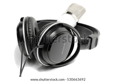 White microphone and black headphones, isolated on white background