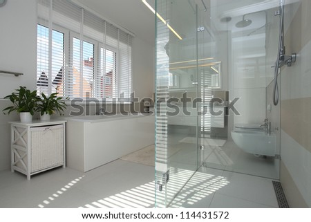 White modern bathroom in stylish house - stock photo