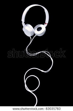 White modern Headphones on a black background - stock photo