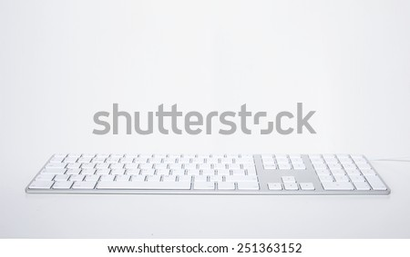white modern keyboard on a gray background. selective focus - stock photo