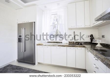 White , modern kitchen with granite tops - stock photo