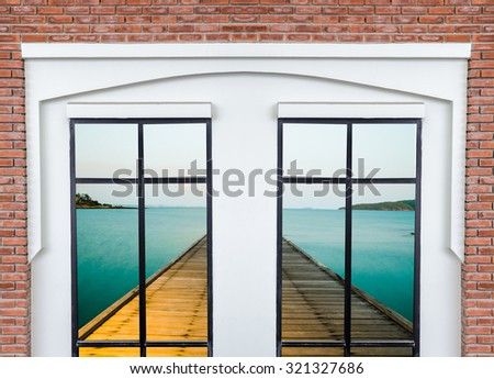 white modern window on brick wall with dock on sea background