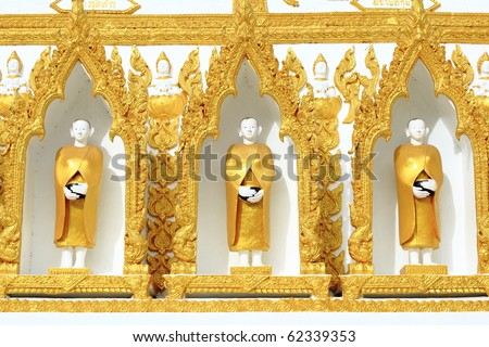 white Monk sculpture dress in gold on pagoda. - stock photo