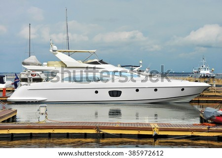 White motor yacht over harbor pier, Odessa, Ukraine