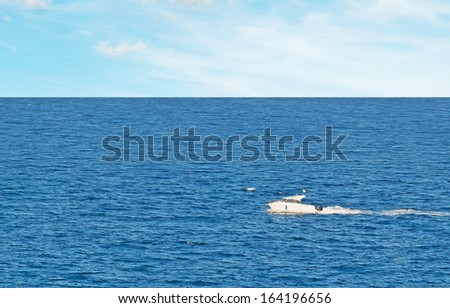 white motorboat cruising in the sea