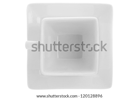 White mug and saucer in a plain background - stock photo