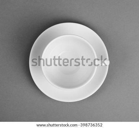 White mug and saucer on a gray background, top view - stock photo