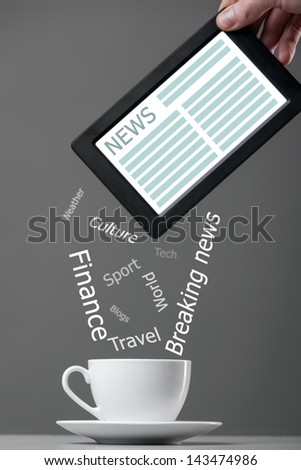 White mug and tablet computer on a gray background. News concept. - stock photo