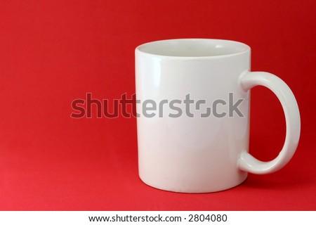 White mug on red background - stock photo