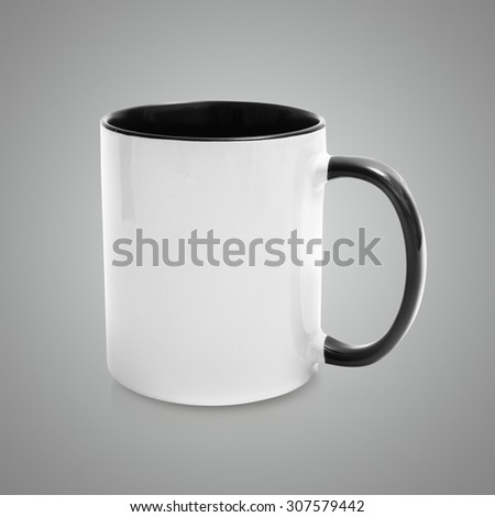 white mug with a black handle and an inner surface  on gray background - stock photo