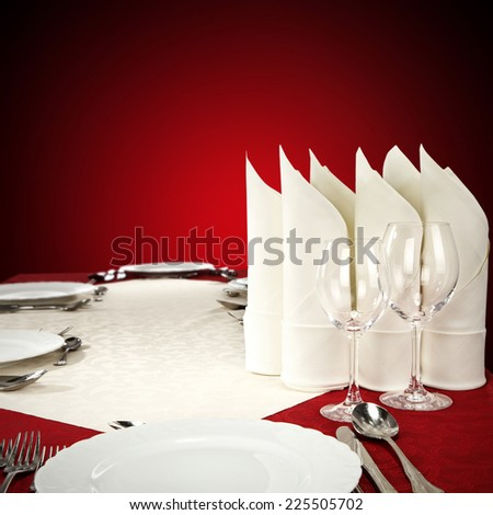 white napkin glasses and plate of xmas  - stock photo