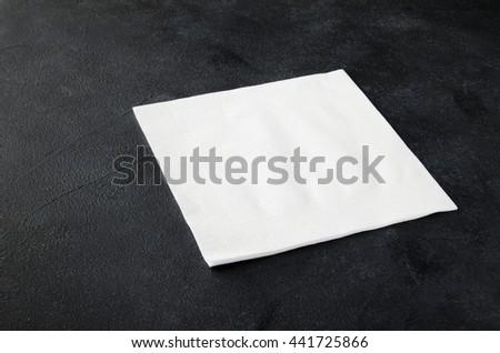 White napkin on a black background. Top view. - stock photo