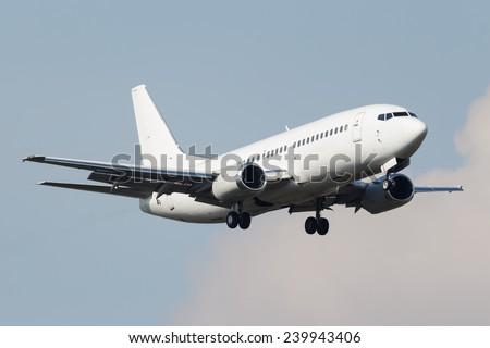 White narrow body airplane approaching runway - stock photo