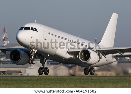 White narrow body airplane shortly after take-off - stock photo