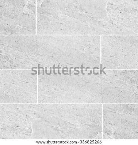 White natural sand stone tile wall seamless background and texture - stock photo