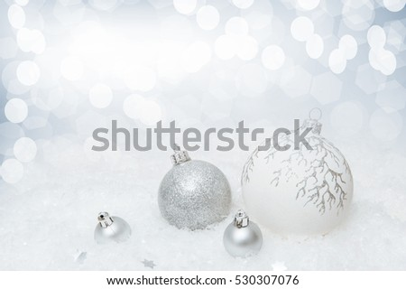 White New Year background with Christmas balls  on an artificial snow with highlights