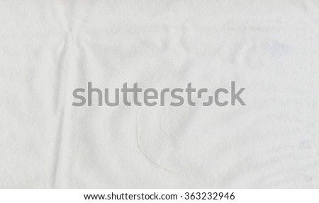 White nonwoven fabric useful as a background