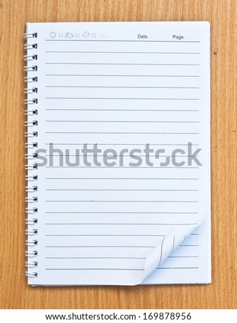 White Note Book Blank Page on Wood Table With Shadow