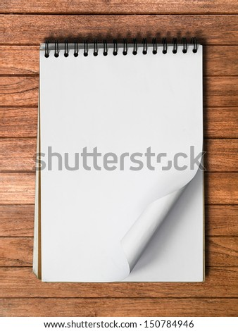 White Note Book Blank Page on Wood Table With Shadow Vertical - stock photo
